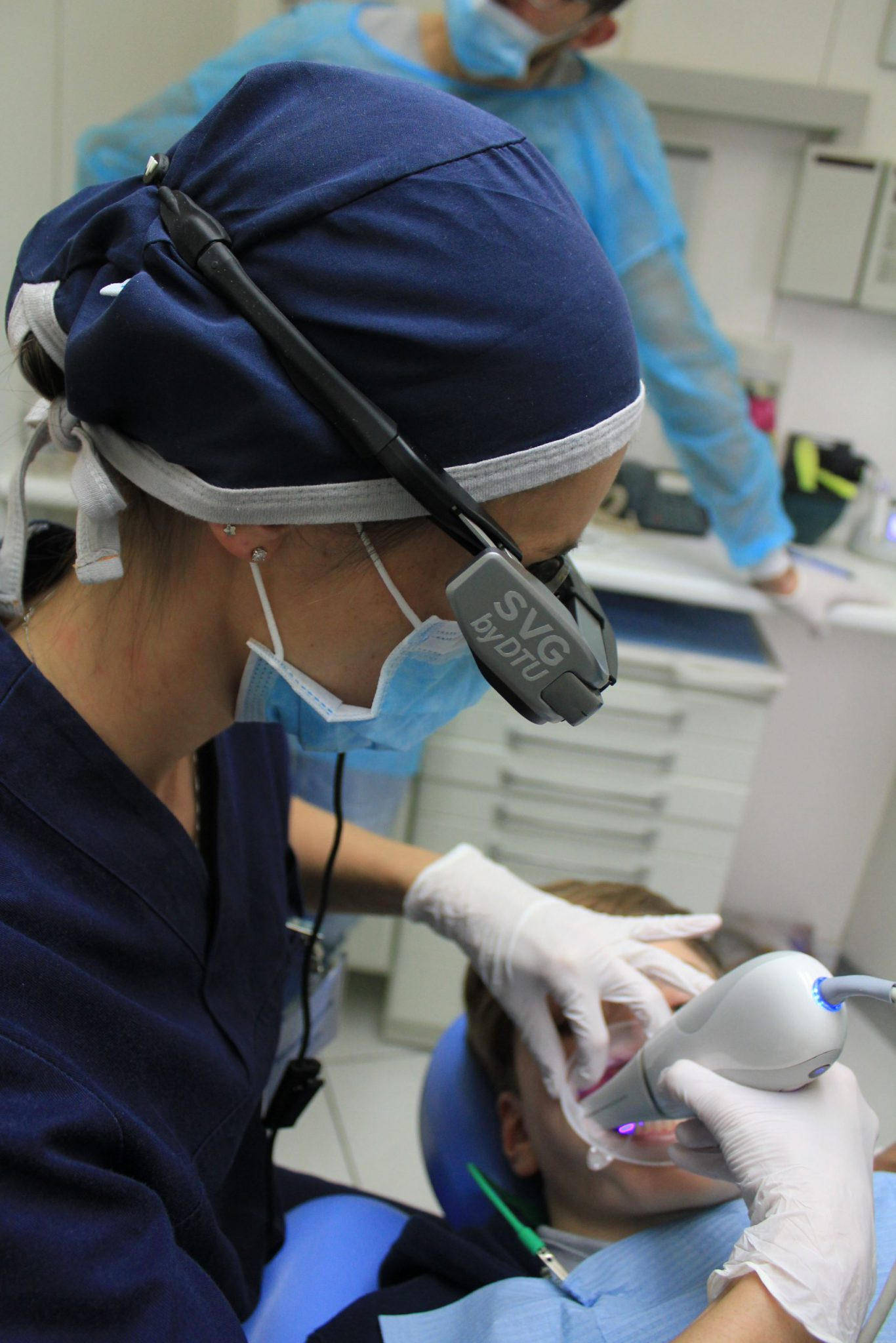 dentists performing laser surgery